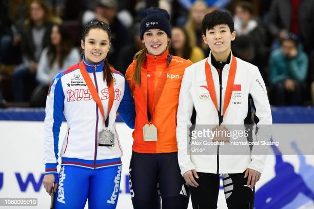 Sofia Prosvirnova of Russia Suzanne Schulting of the Netherlands and Kexin Fan of China pose for a picture after the ladies 1000m final during ISU...