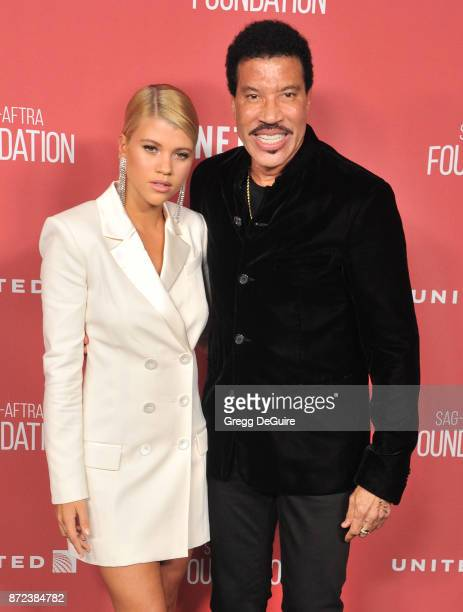 Sofia Richie and Lionel Richie arrive at the SAGAFTRA Foundation Patron of the Artists Awards 2017 on November 9 2017 in Beverly Hills California