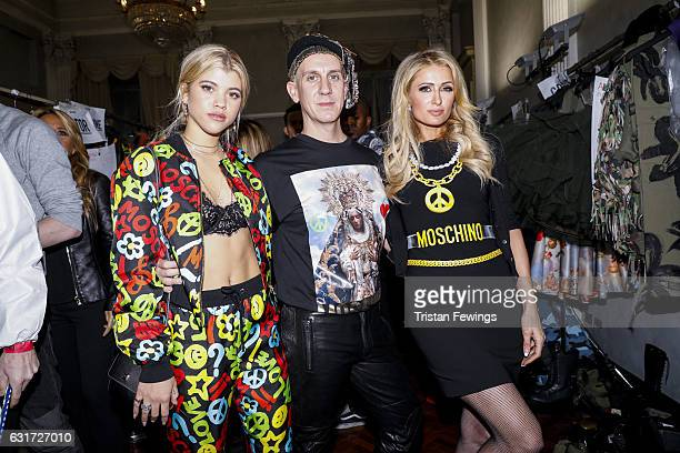 Sofia Richie Jeremy Scott and Paris Hilton are seen backstage ahead of the Moschino show during Milan Men's Fashion Week Fall/Winter 2017/18 on...