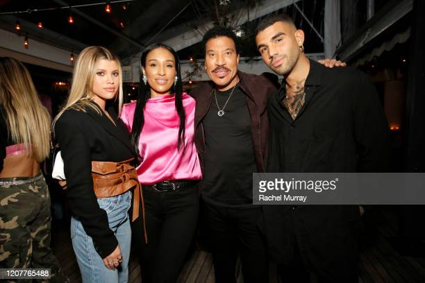 Sofia Richie Lisa Parigi Lionel Richie and Miles Richie attend Rolla's x Sofia Richie Launch Event at Harriet's Rooftop on February 20 2020 in West...