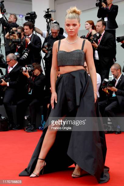 Sofia Richie walks the red carpet ahead of the Opening Ceremony and the La Vérité screening during the 76th Venice Film Festival at Sala Grande on...