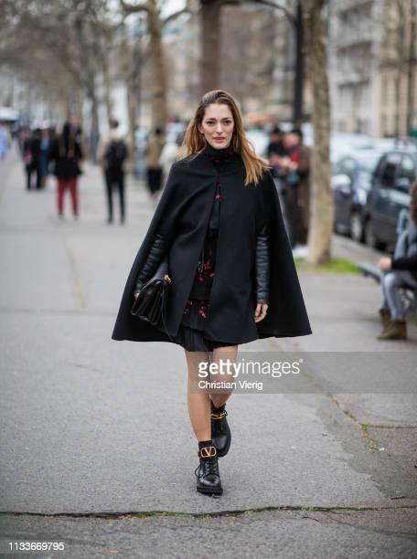 Sofia Sanchez de Betak is seen wearing black cape outside Valentino during Paris Fashion Week Womenswear Fall/Winter 2019/2020 on March 03 2019 in...