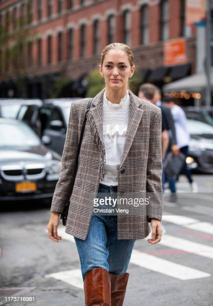 Sofia Sanchez de Betak is seen wearing denim jeans checkered blazer brown boots white blouse outside Gabriela Hearst during New York Fashion Week...