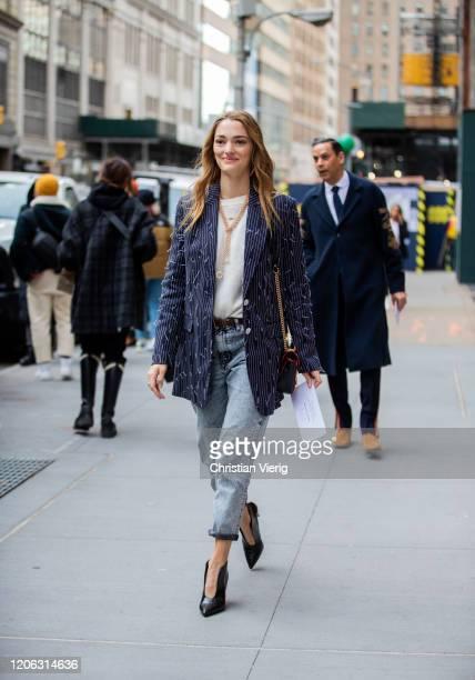 Sofia Sanchez de Betak is seen wearing striped blazer, denim jeans outside Michael Kors during New York Fashion Week Fall / Winter 2020 on February...