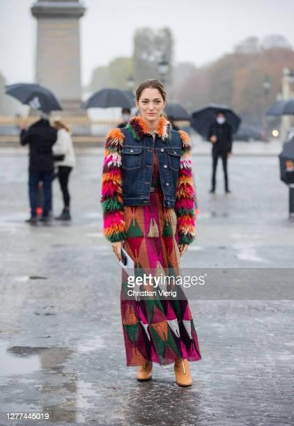Sofia Sanchez de Betak seen wearing denim jacket with fur sleeves, dress with pattern outside Dior during Paris Fashion Week - Womenswear Spring...