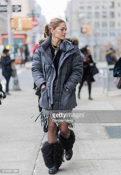 Sofia Sanchez de Betak wearing a Moncler jacket and a black white Dion Lee skirt with fringes and black fake fur boots seen outside Lacoste during...