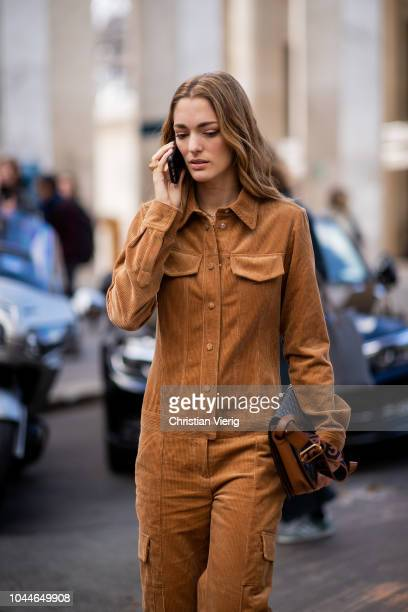 Sofia Sanchez De Betak wearing brown corduroy overall is seen outside Sacai during Paris Fashion Week Womenswear Spring/Summer 2019 on October 1 2018...