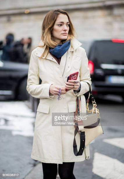 Sofia Sanchez de Betak wearing creme white coat Chloe bag ankle boots is seen outside Chloe on March 1 2018 in Paris France