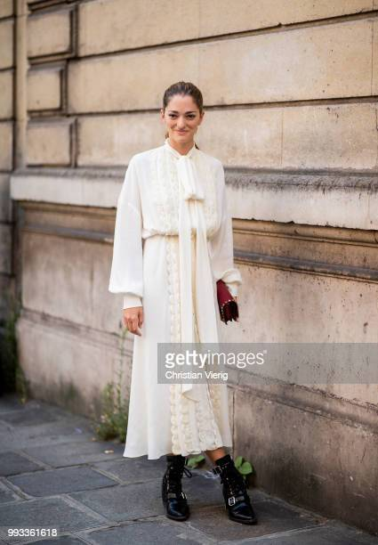 Sofia Sanchez de Betak wearing white dress seen outside Valentino on day four during Paris Fashion Week Haute Couture FW18 on July 4 2018 in Paris...