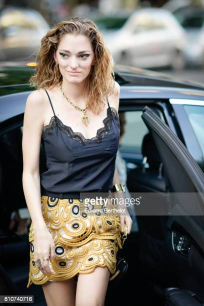 Sofia Sanchez de Betak wears a lace tank top a golden skirt with embroidery outside the Vogue Foundation Dinner during Paris Fashion Week Haute...