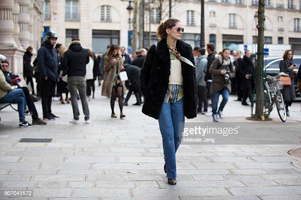 Sofia Sanchez de Betak wears a scarf Anushka Elliott and a Chloe sweater at the Bouchra Jarrar show at Mairie du 4e on January 26 2016 in Paris France