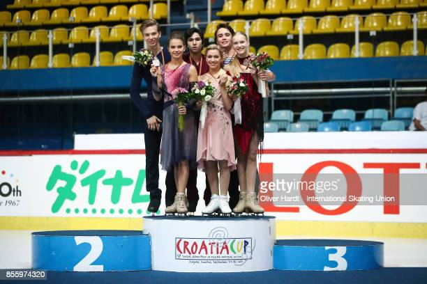 Sofia Shevchenko and Igor Eremenko of Russia with the silver medal Marjorie Lajoie and Zachary Lagha of Canada with the gold medal and Ksenia Konkina...