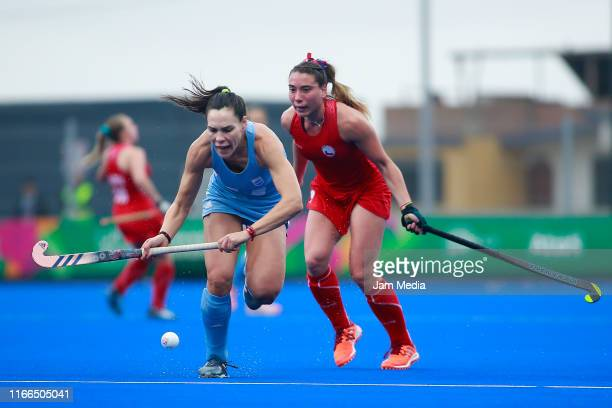 Sofia Toccalino of Argentina competes for the ball with Denise Krimerman of Chile during Hockey Women Semifinals on Day 11 of Lima 2019 Pan American...