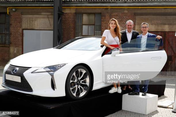 Sofia Tsakiridou, Frank Levy and Heiko Tvellmann pose in a Lexus at the 3D Fashion Presented By Lexus/Voxelworld show during Platform Fashion July...