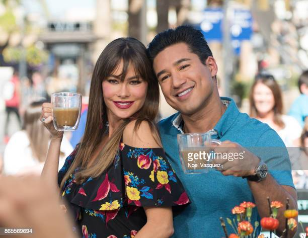 Sofia Vergara and Mario Lopez drink coffee together at 'Extra' at Universal Studios Hollywood on October 23 2017 in Universal City California