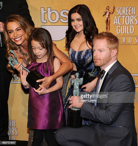 Sofia Vergara Ariel Winter Aubrey AndersonEmmons and Jesse Tyler Ferguson pose in the press room at the 20th annual Screen Actors Guild Awards at The...