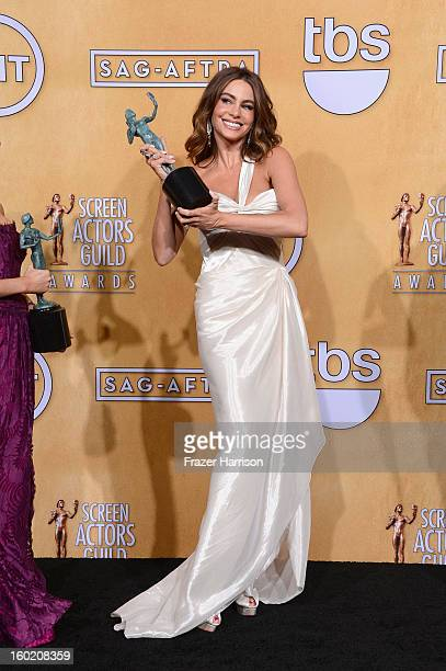 Sofia Vergara one of the winners of Outstanding Performance by an Ensemble in a Comedy Series for Modern Family poses in the press room during the...