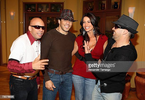 Sofia Vergara poses with members of the Latin band Grupo Mania on the new set of Escandalo TV for their 5th Anniversay episode on January 22 2007 in...