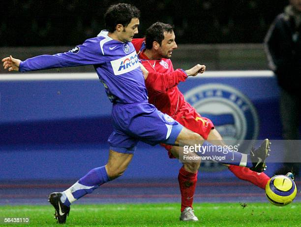 Sofian Chahed of Hertha Berlin tussles for the ball with Gabriel Bostina of Bucharest during the UEFA Cup Group C match between Hertha BSC Berlin and...