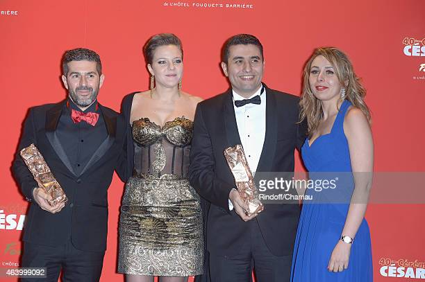 Sofian El Fani a guest Amine Bouhafa and a guest arrive for dinner after the 40th Cesar Film Awards 2015 at Le Fouquet's on February 20 2015 in Paris...