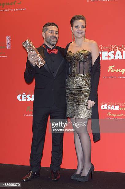 Sofian El Fani and a guest arrive for dinner after the 40th Cesar Film Awards 2015 at Le Fouquet's on February 20 2015 in Paris France