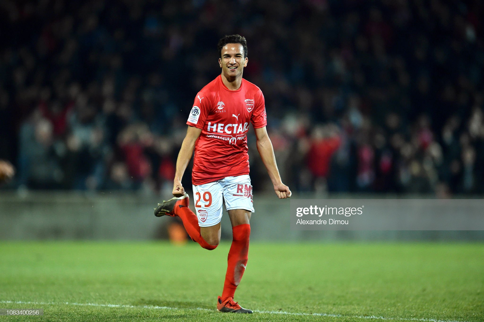 32 EME JOURNEE DE LIGUE 1 CONFORAMA : OM - NO  Sofiane-alakouch-of-nimes-celebrates-scoring-his-first-sides-goal-picture-id1083400256?s=2048x2048