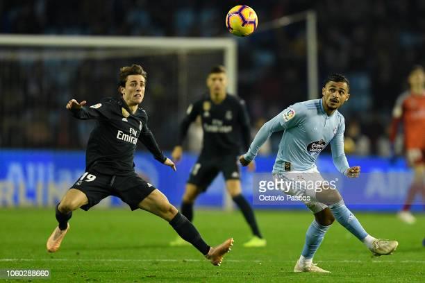 Sofiane Boufal of Celta de Vigo competes for the ball with Alvaro Odriozola of Real Madrid during the La Liga match between RC Celta de Vigo and Real...