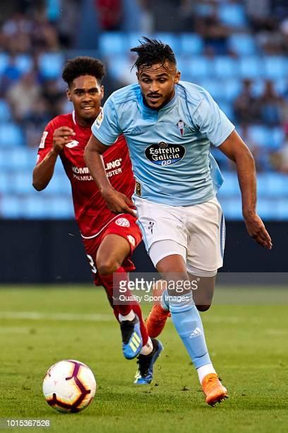 Sofiane Boufal of Celta de Vigo is challenged by Philipp Mwene of Mainz 05 during the preseason friendly match between Celta de Vigo and Mainz 05 at...