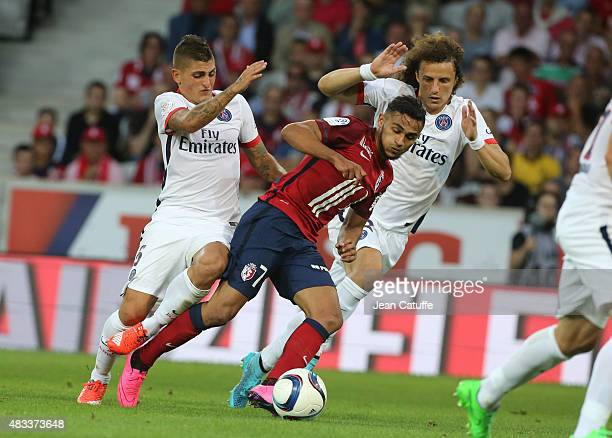 Sofiane Boufal of Lille in action between Marco Verratti and David Luiz of PSG during the French Ligue 1 match between Lille OSC and Paris...