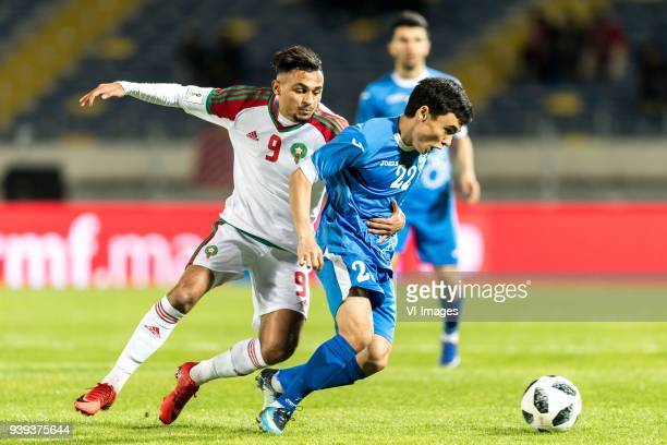 Sofiane Boufal of Morocco Javokhir Sidikov of Uzbekistan during the international friendly match between Morocco and Uzbekistan at the Stade Mohammed...