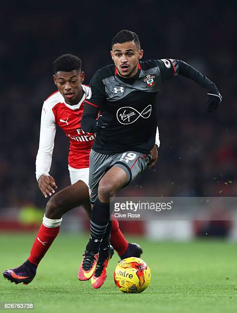 Sofiane Boufal of Southampton advances under pressure from Jeff ReineAdelaide of Arsenal during the EFL Cup quarter final match between Arsenal and...