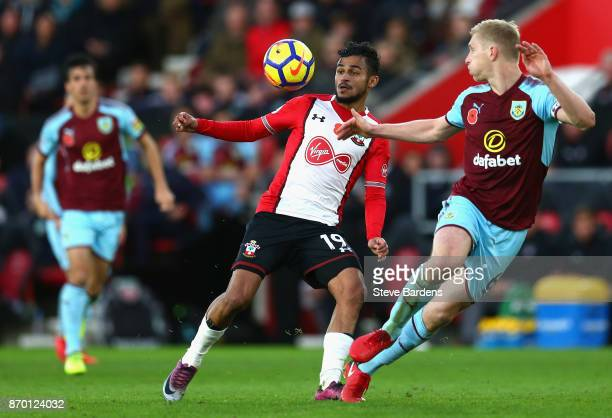 Sofiane Boufal of Southampton and Ben Mee of Burnley in action during the Premier League match between Southampton and Burnley at St Mary's Stadium...