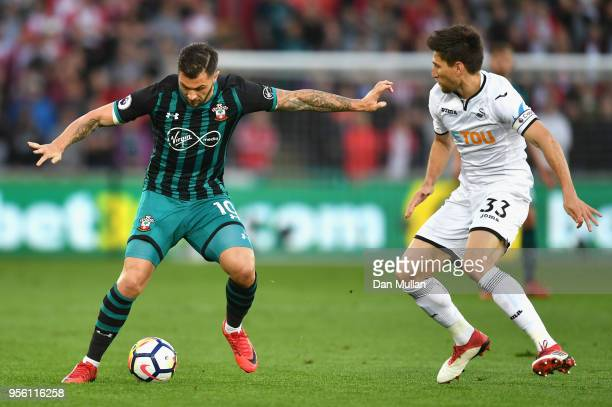 Sofiane Boufal of Southampton and Federico Fernandez of Swansea City in action during the Premier League match between Swansea City and Southampton...