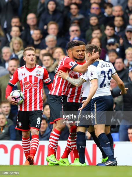 Sofiane Boufal of Southampton and Harry Winks of Tottenham Hotspur exchange words during the Premier League match between Tottenham Hotspur and...