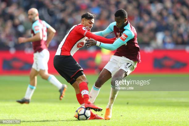 Sofiane Boufal of Southampton battles for possesion with Edimilson Fernandes of West Ham United during the Premier League match between West Ham...