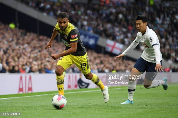 Sofiane Boufal of Southampton battles for possession with HeungMin Son of Tottenham Hotspur during the Premier League match between Tottenham Hotspur...