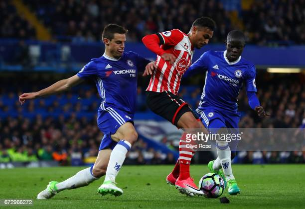 Sofiane Boufal of Southampton battles with Cesar Azpilicueta and N'Golo Kante of Chelsea during the Premier League match between Chelsea and...