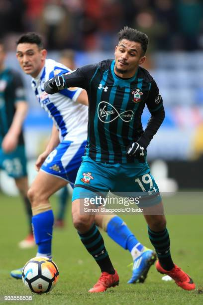 Sofiane Boufal of Southampton battles with Gary Roberts of Wigan during The Emirates FA Cup Quarter Final match between Wigan Athletic and...