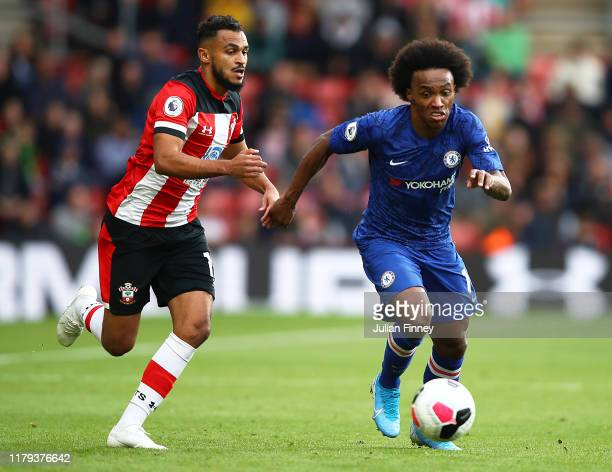 Sofiane Boufal of Southampton battles with William of Chelsea during the Premier League match between Southampton FC and Chelsea FC at St Mary's...