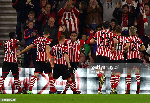 Sofiane Boufal of Southampton celebrates scoring his sides first goal with his Southampton team mates during the EFL Cup fourth round match between...
