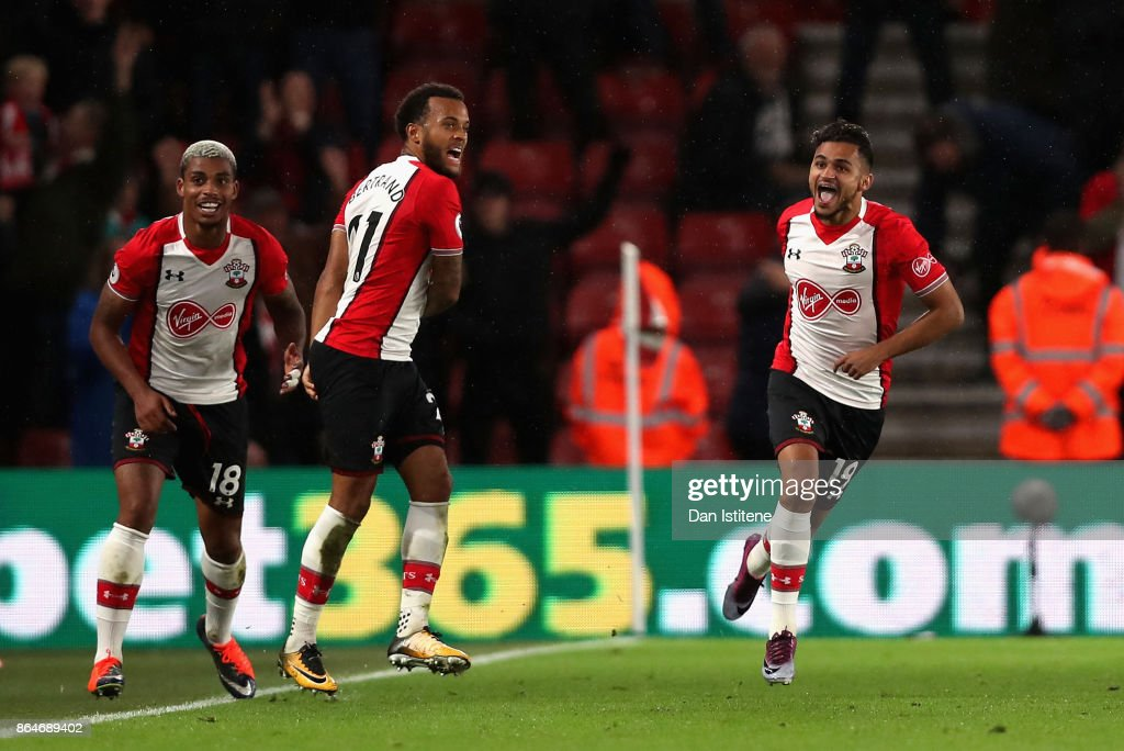 Sofiane Boufal of Southampton celebrates with teammates after scoring his sides first goal during the Premier League match between Southampton and West Bromwich Albion at St Mary's Stadium on October 21, 2017 in Southampton, England.