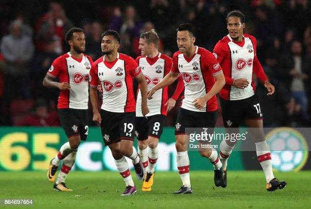Sofiane Boufal of Southampton celebrates with teammates after scoring his sides first goal during the Premier League match between Southampton and...