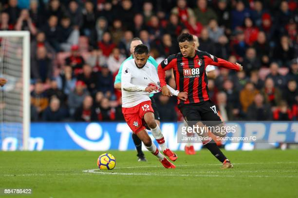 Sofiane Boufal of Southampton FC takes on Joshua King during the Premier League match between AFC Bournemouth and Southampton at Vitality Stadium on...