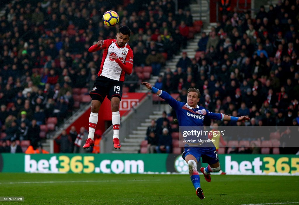 Sofiane Boufal of Southampton heads the ball under pressure from Moritz Bauer of Stoke during the Premier League match between Southampton and Stoke City at St Mary's Stadium on March 3, 2018 in Southampton, England.