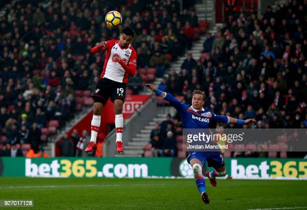 Sofiane Boufal of Southampton heads the ball under pressure from Moritz Bauer of Stoke during the Premier League match between Southampton and Stoke...