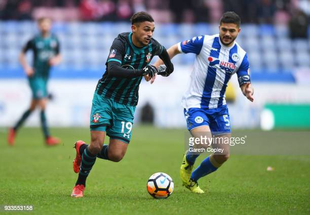 Sofiane Boufal of Southampton is chased by Sam Morsy of Wigan Athletic during The Emirates FA Cup Quarter Final match between Wigan Athletic and...