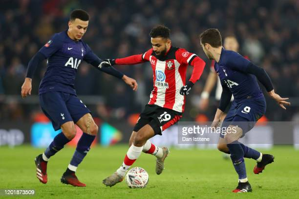 Sofiane Boufal of Southampton runs from Dele Alli and Harry Winks of Tottenham Hotspur during the FA Cup Fourth Round match between Southampton FC...