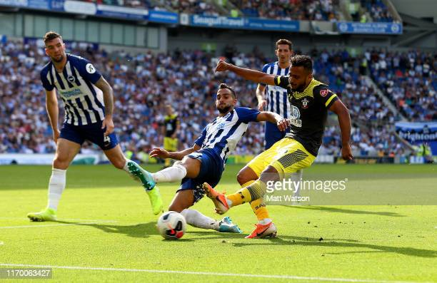 Sofiane Boufal of Southampton shoots across goal for Nathan Redmond to score during the Premier League match between Brighton Hove Albion and...