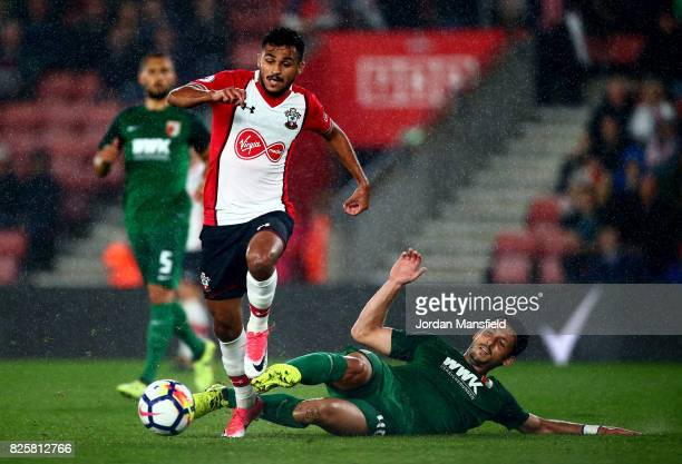 Sofiane Boufal of Southamton is tackled by Gojko Kacar of FC Augsburg during the PreSeason Friendly match between Southampton and FC Augsburg at St...
