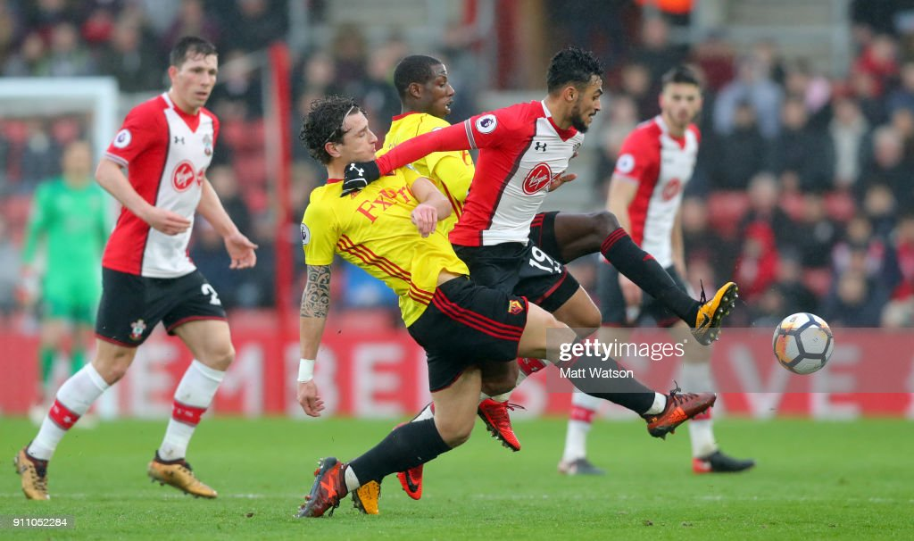 Sofiane Boufal(centre)of Southampton FC under pressure from two Watford players during the FA Cup 4th round match between Southampton FC and Watford, at St Mary's Stadium on January 27, 2018 in Southampton, England.